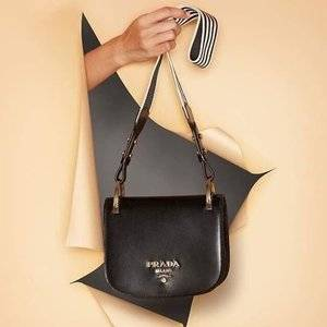 f5c24970fe5326 Up to 60% off Prada bags and shoes @SSENSE - Extrabux